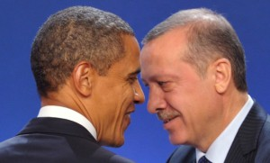 U.S. President Barack Obama (L) and Turkey's Prime Minister Recep Tayyip Erdogan take part in a family photo during the G20 Summit of major world economies in Cannes November 3, 2011.   REUTERS/Philippe Wojazer (FRANCE  - Tags: POLITICS BUSINESS)   - RTR2TKEP