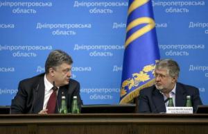 Ukrainian President Poroshenko talks to oligarch Kolomoisky during representing ceremony of new Dnipropetrovsk governor