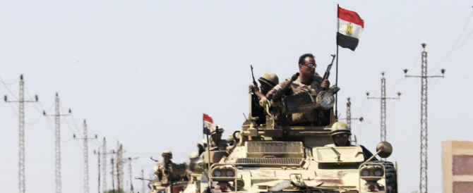 Soldiers in military vehicles proceed towards al-Jura district in El-Arish city from Sheikh Zuwaid