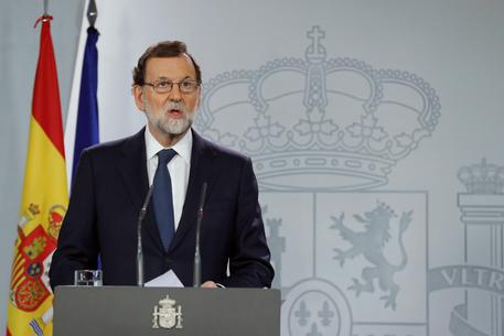 Spanish Prime Minister Mariano Rajoy gives a statement after an extraordinary Cabinet meeting