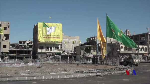 SDF,_YPG,_and_YPJ_flags_in_Raqqa_centre.png