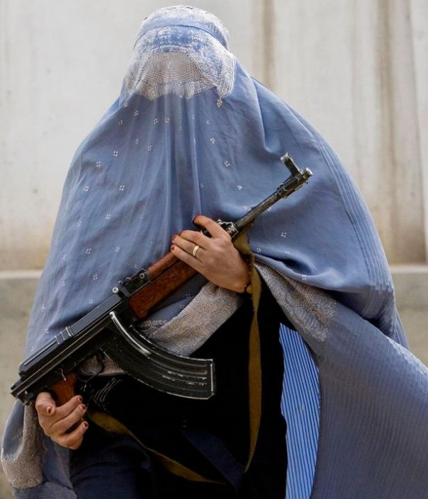 wearing-a-burka-holds-a-AK47-.File-Photo.