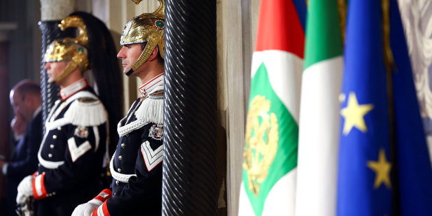 Members of Italian elite military unit Cuirassiers' Regiment, who are honor guards for the Italian President Sergio Mattarella, stand guard during the first day of consultations at the Quirinal Palace in Rome