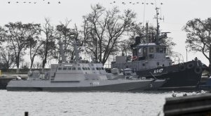Three Ukrainian ships are seen as they docked after been seized ate Sunday, Nov. 25, 2018, in Kerch, Crimea, Monday, Nov. 26, 2018. The Ukrainian parliament is set to consider a presidential request for the introduction of martial law in Ukraine following an incident in which Russian coast guard ships fired on Ukrainian navy vessels. (ANSA/AP Photo) [CopyrightNotice: Copyright 2018 The Associated Press. All rights reserved.]